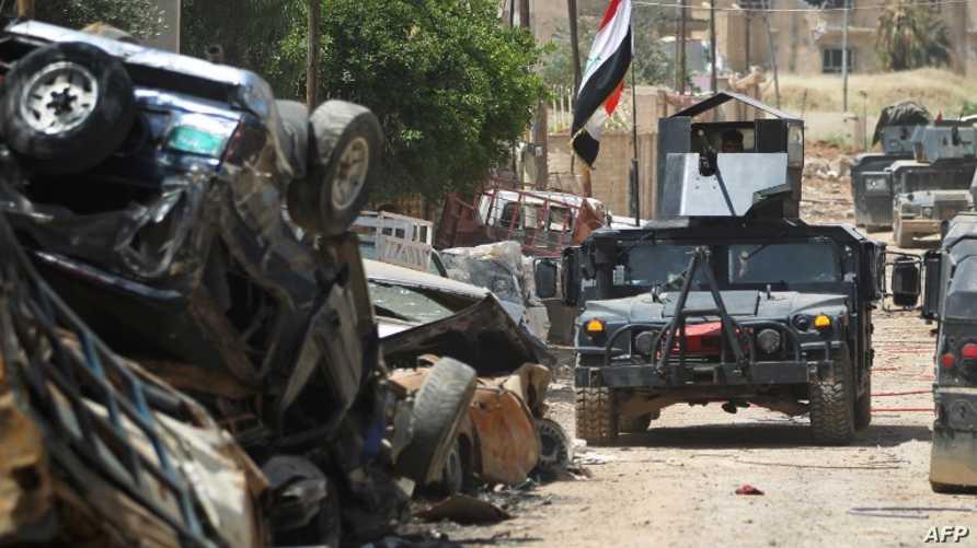 قوة من جهاز مكافحة الإرهاب أثناء عمليات تحرير الموصل/وكالة الصحافة الفرنسية