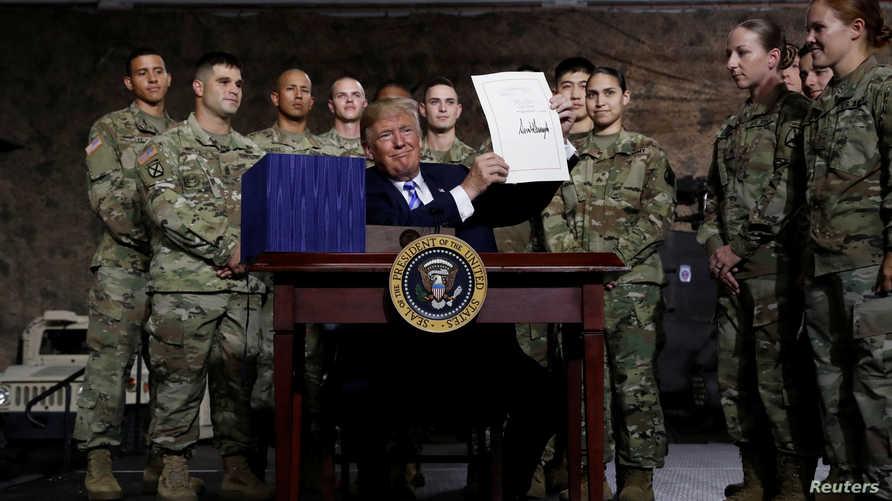 ترامب بعد توقيعه قانون موازنة الدفاع