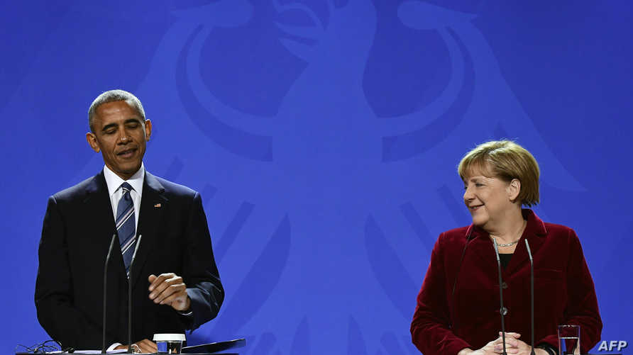 أوباما وميركل خلال المؤتمر الصحافي المشترك في برلين الخميس