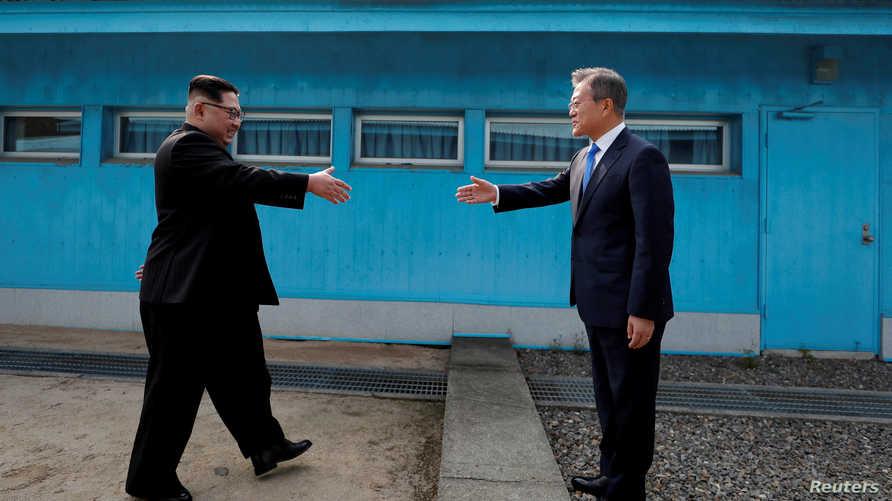 الرئيس الكوري الجنوبي مون جاي إن ونظيره الكوري الشمالي كيم جونغ أون