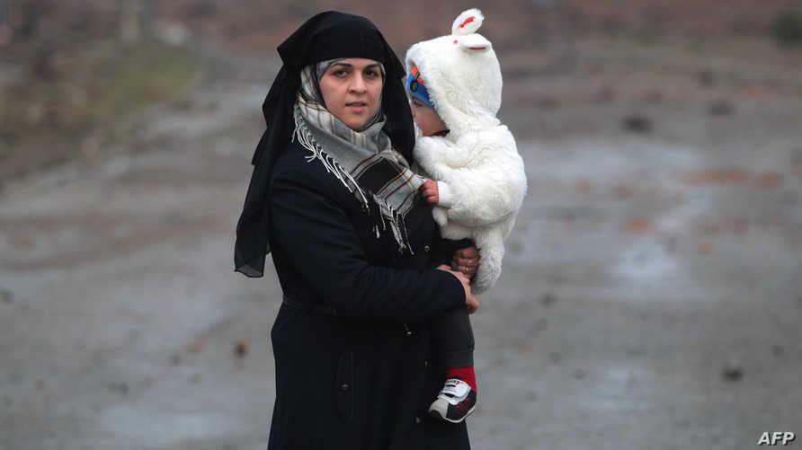 امرأة عراقية فرت من تنظيم داعش في الموصل