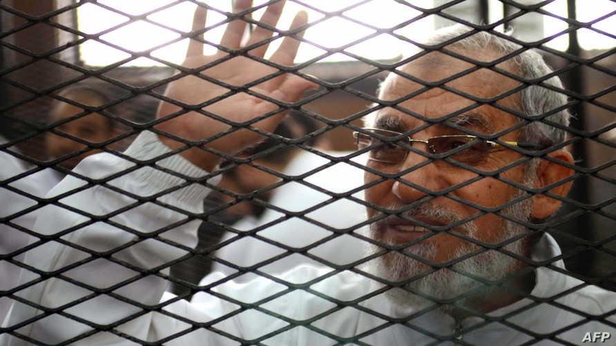 محمد بديع وراء القضبان