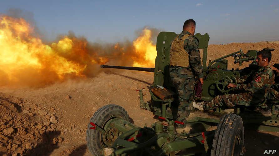 عناصر في قوات البيشمركة خلال عملية قرب قرية حسن شمس شرق الموصل