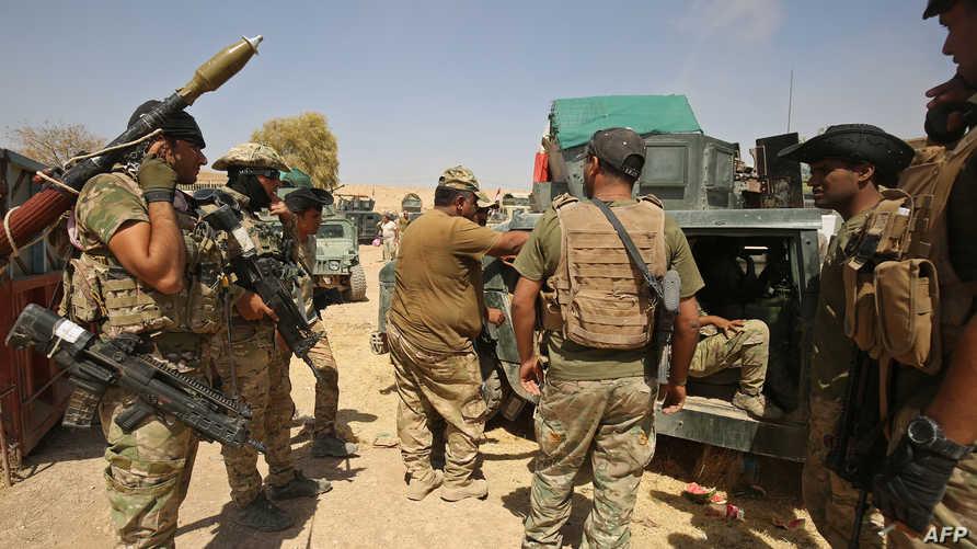 قوات عراقية خلال تقدمها شمالي تلعفر نهاية آب