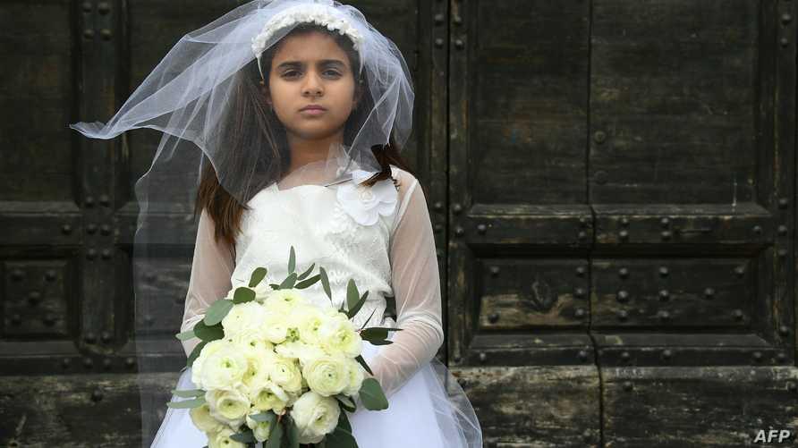 طفلة تمثل دور زوجة قاصرة ـ أرشيف