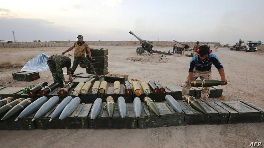 عناصر في القوات العراقية خلال الاستعدادات لعملية استعادة الفلوجة من داعش