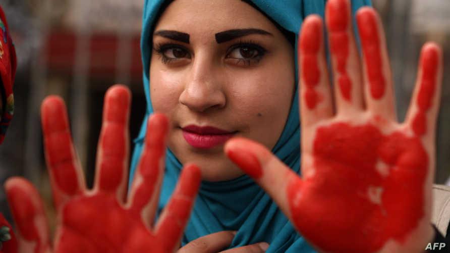 مشاركة في تظاهرة رفضا للعنف ضد المرأة في بيروت - أرشيف