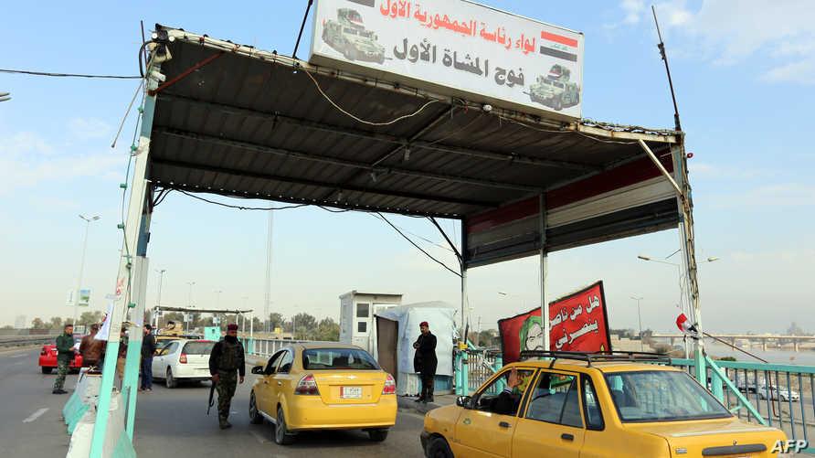 نقطة تفتيش أقامتها قوات الأمن العراقية في منطقة الدورة