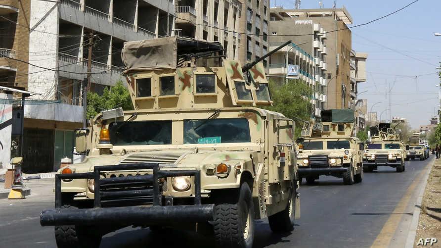 عربات عسكرية في منطقة الكرادة في بغداد
