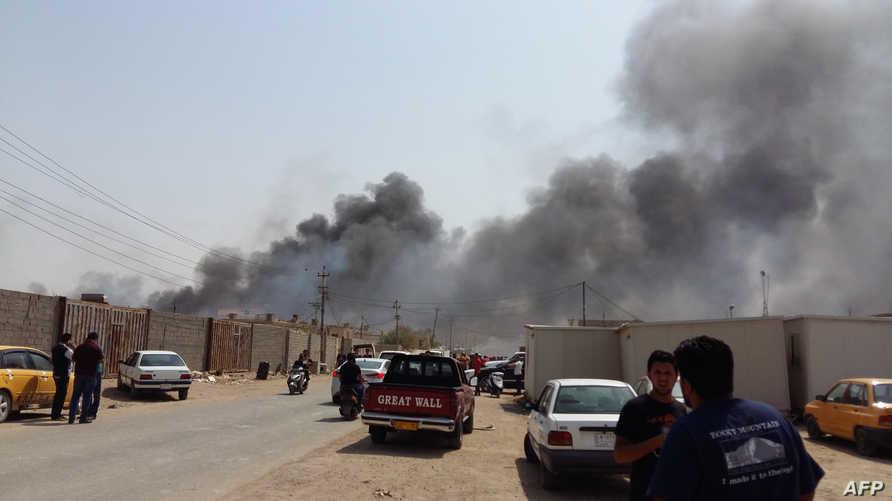 دخان متصاعد إثر  تفجير سابق في العاصمة العراقية بغداد