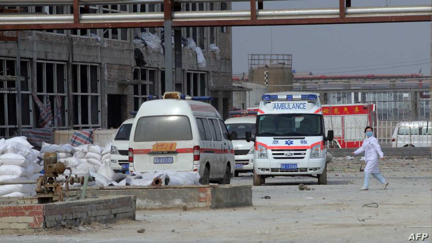 سيارات إسعاف في موقع انفجار سابق بمصنع كيماوي في الصين- أرشيف