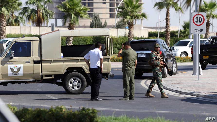 عناصر أمن قرب موقع الهجوم في أربيل عاصمة إقليم كردستان