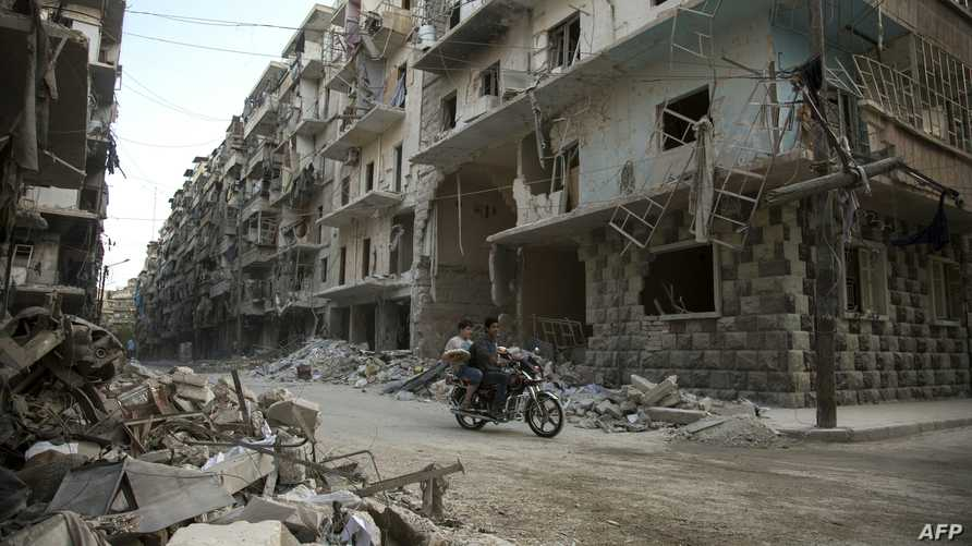 سوريان في حي بستان القصر في حلب