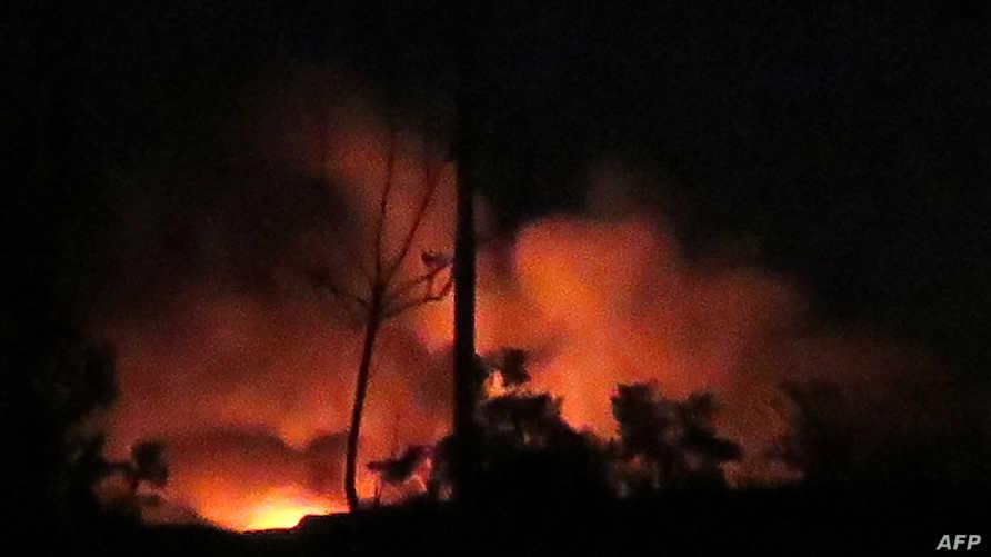 صورة للنيران المشتعلة في مطار المزة العسكري