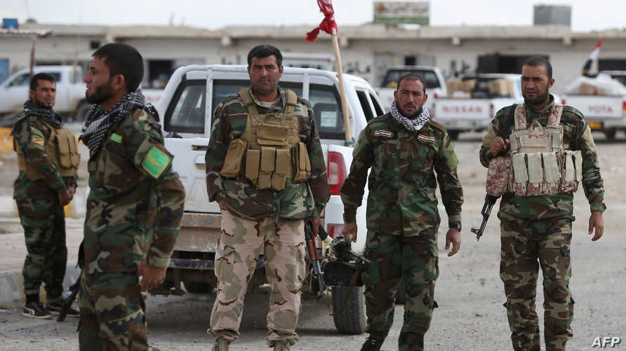 عناصر مسلحة تقاتل إلى جانب القوات العراقية في تكريت