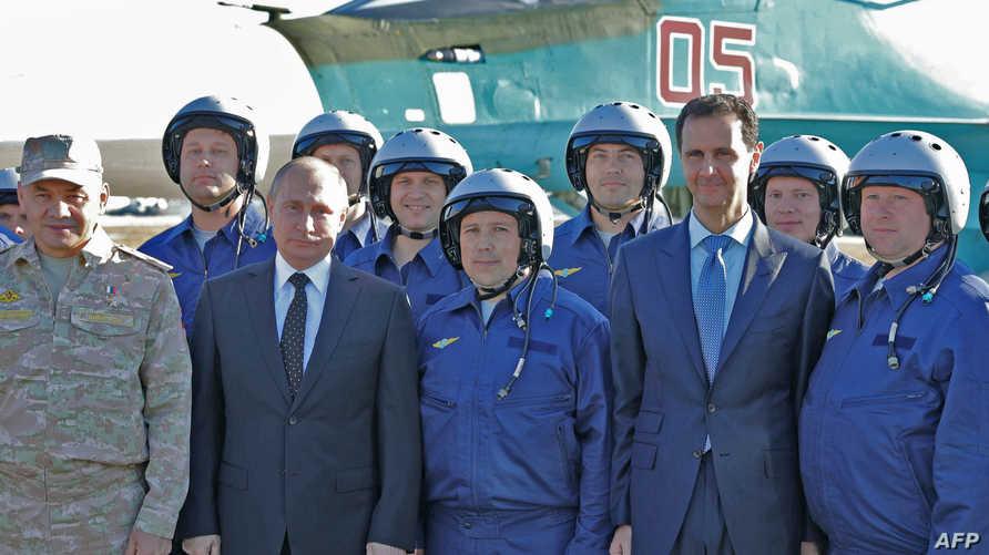 الرئيس الروسي بوتين خلال زيارته لقاعدة حميميم في سوريا