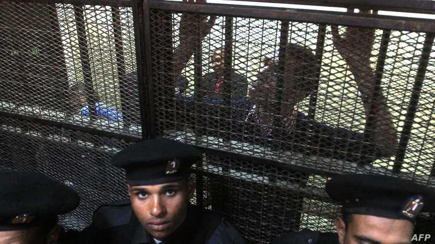 أحد الناشطين المصريين العاملين في منظمات المجتمع المدني خلال محاكمتهم عام 2012 (أرشيف)