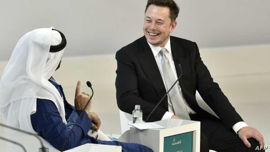 مدير تسلا التنفيذي إيلون ماسك ووزير شؤون مجلس الوزراء والمستقبل محمد القرقاوي