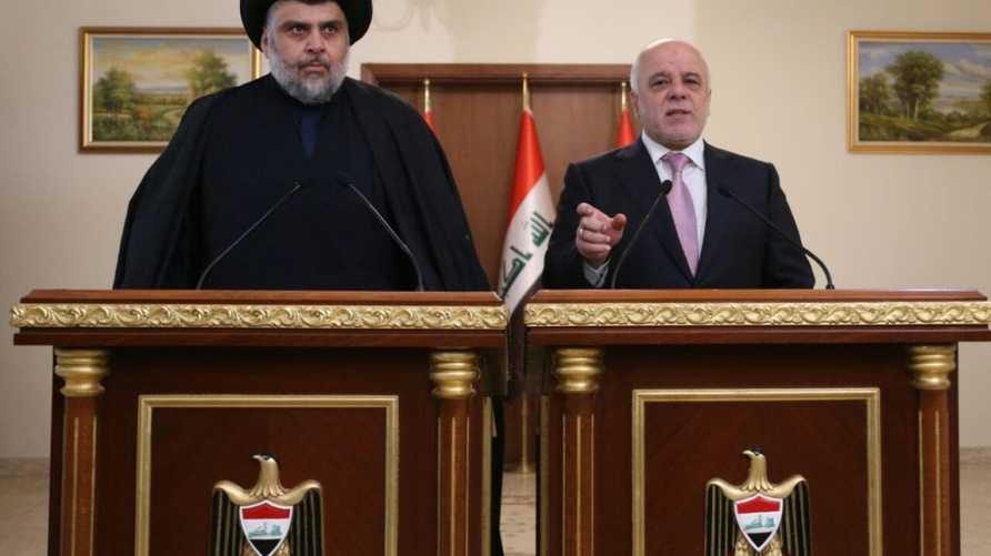 العبادي والصدر خلال مؤتمرهما الصحافي - الصورة من موقع مكتب رئيس الوزراء العراقي