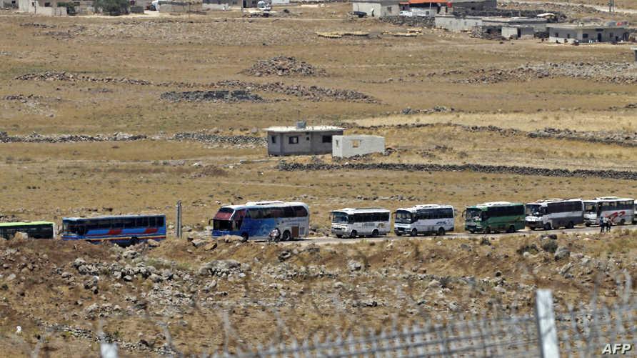 حافلات تنقل مقاتلين معارضين للنظام السوري في جنوب البلاد - أرشيف