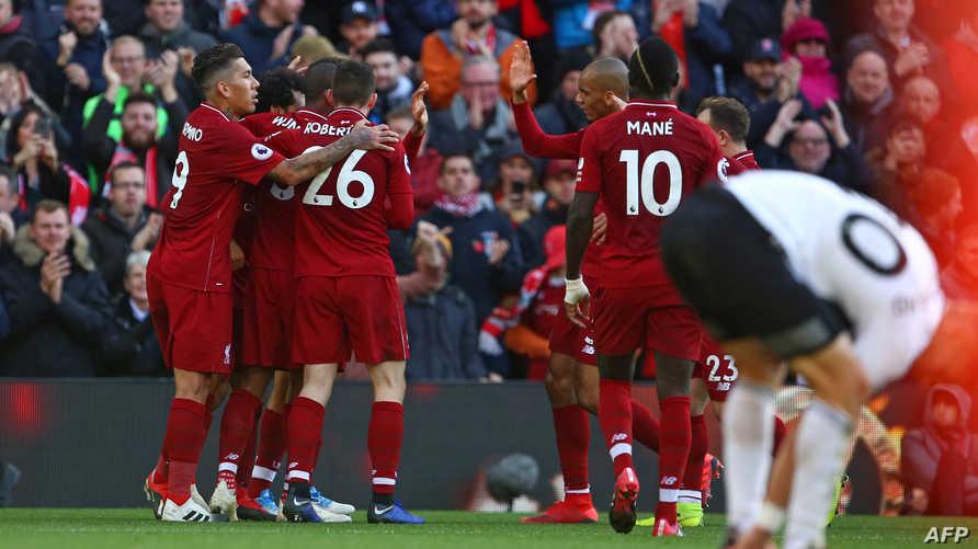 لاعبو ليفربول يحتفلون بالهدف الأول ضد فولهام