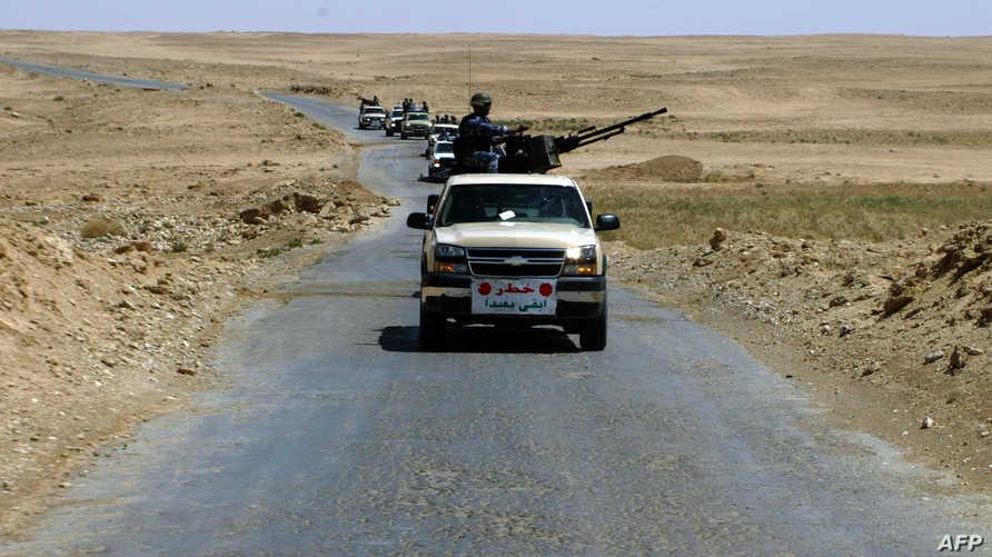 عربة عسكرية تابعة للجيش العراقي في إحدى طرقات حديثة