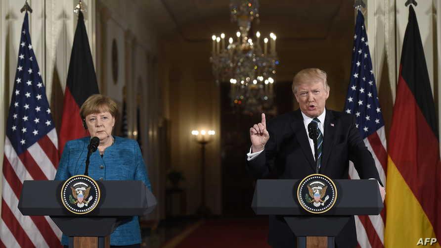ترامب في لقائه مع ميركل بالبيت الأبيض