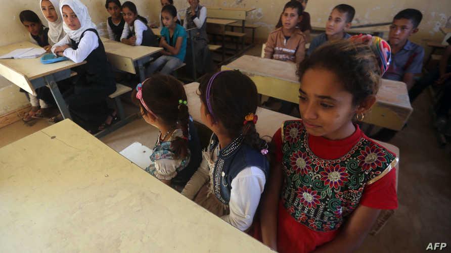أطفال عراقيون على مقاعد الدراسة