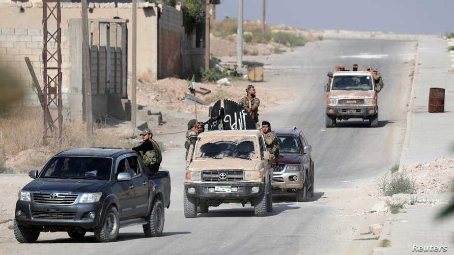 قوات المعارضة السورية المدعوة من تركيا في مدينة تل أبيض الحدودية في 14 أكتوبر 2019