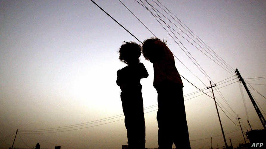 يعاني أطفال مقاتلي داعش من تبعات انضمام أبائهم للتنظيم Photo: AFP