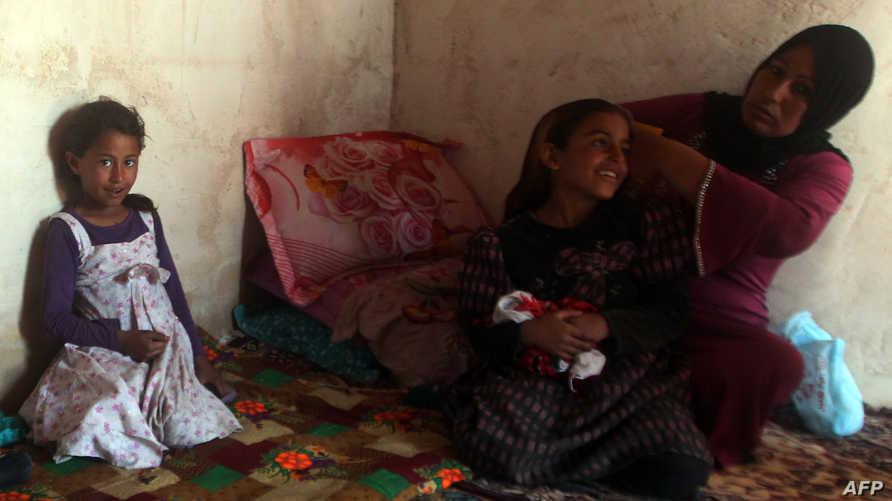 عائلة عراقية تعاني من ظروف معيشية قاسية - أرشيف