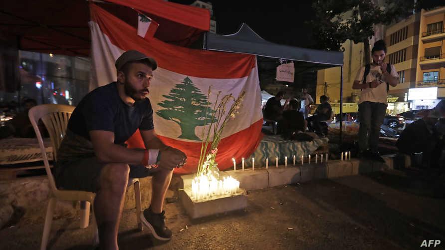 إضاءة شموع في بيروت تضامنا مع المتظاهرين الذين تعرضوا للقمع في مناطق لبنانية أخرى