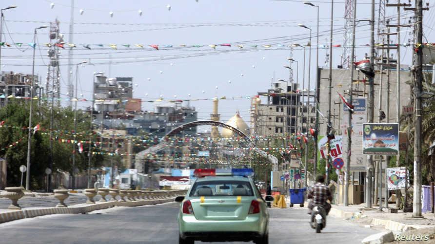 سيارة شرطة في أحد شوارع كربلاء