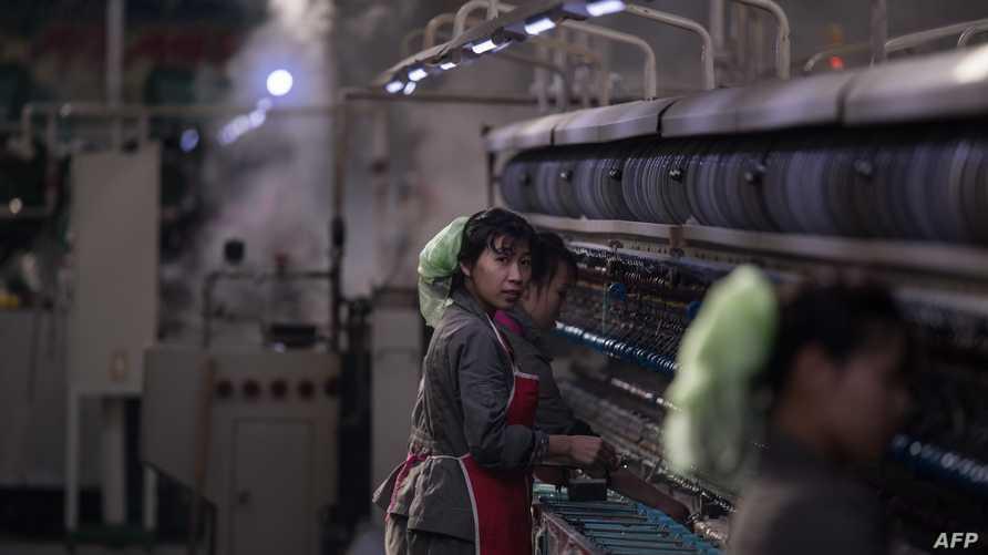 عمال كوريون شماليون في بيونغ يانغ - أرشيف