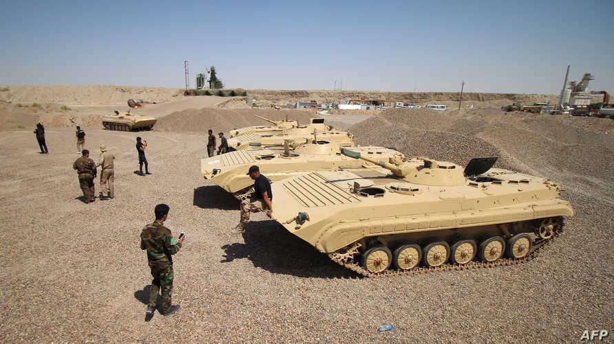 عناصر في القوات المشتركة العراقية في إحدى مناطق القتال ضد داعش- أرشيف