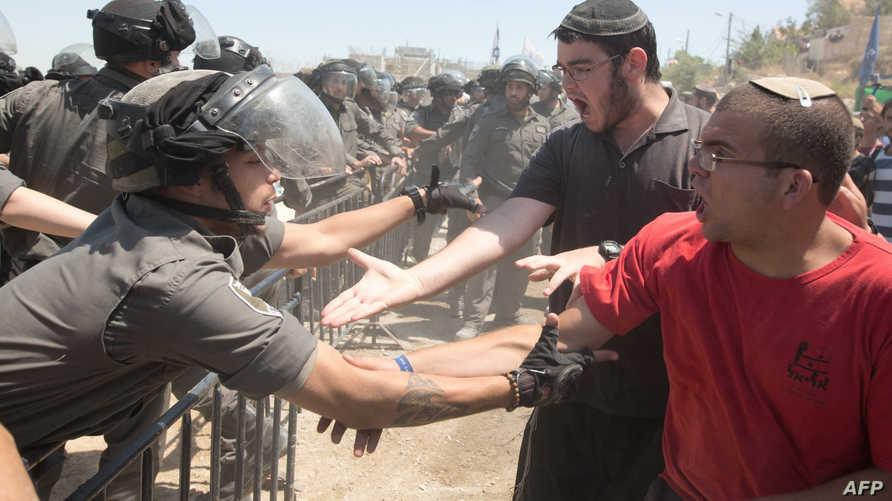 اشتباكات بين مستوطنين وقوات الأمن الإسرائيلية  في بيت إيل شمالي رام الله