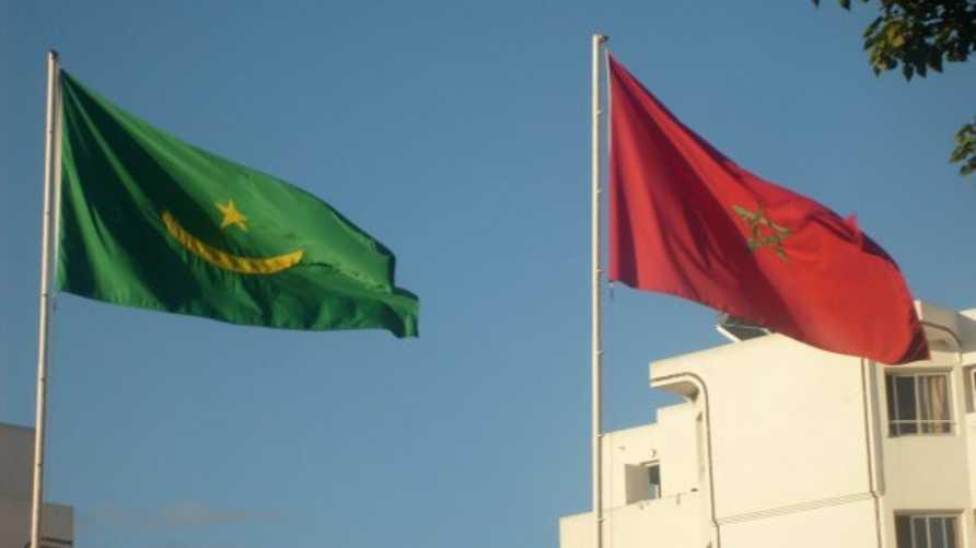 العلمان الموريتاني والمغربي في الرباط بمناسبة احتفال الجالية الموريتانية بعيد استقلال بلادها