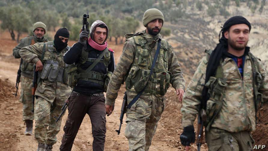 مقاتلون تابعون لفصائل سورية موالية لتركيا