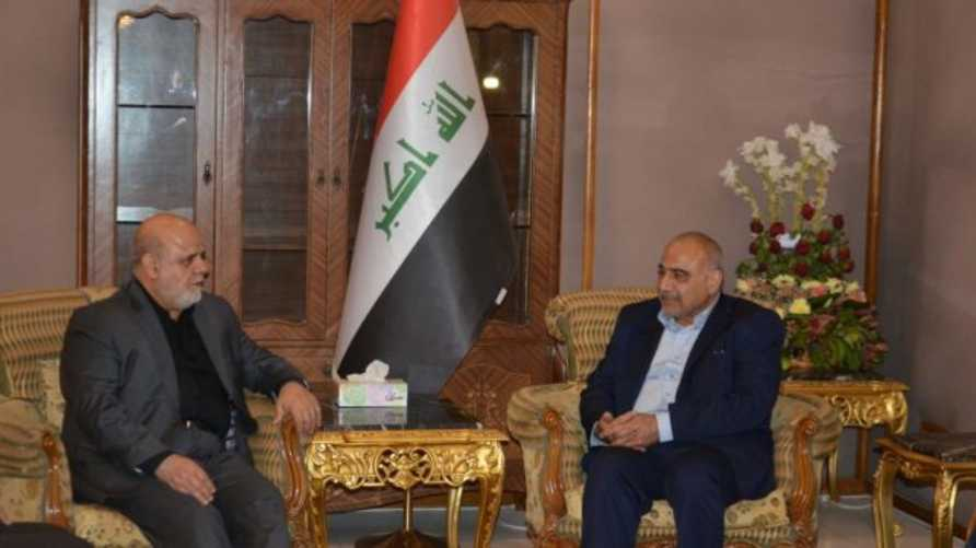 رئيس الوزراء العراقي عادل عبد المهدي والسفير الإيراني في بغداد إيرج مسجدي