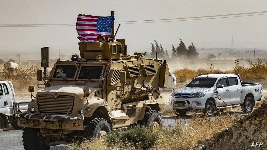 مدرعة أميركية قرب قاعدة التحالف الدولي في مدينة رأس العين شمالي سوريا، 6 أكتوبر