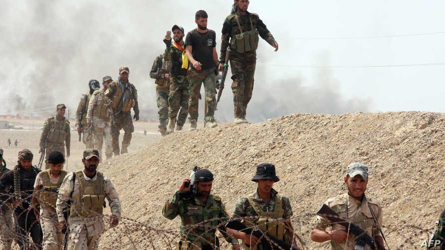 أفراد من القوات الأمنية العراقية وعناصر الحشد الشعبي وأبناء العشائر