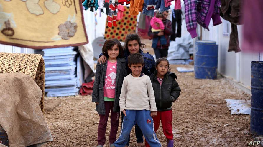 أطفال أيزيديون في مخيم للاجئين في دهوك