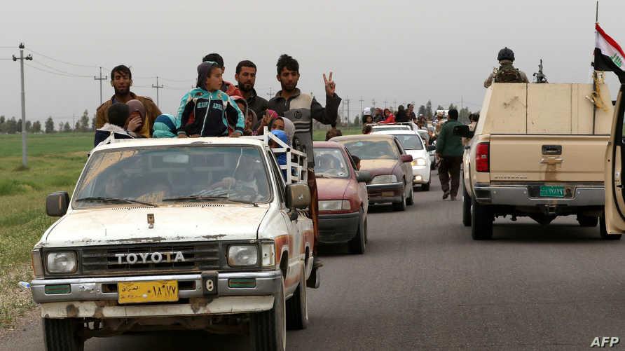 عائلات هربت من مناطق القتال قرب الموصل