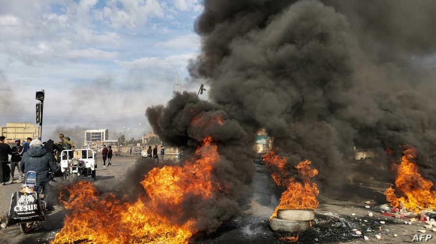 شهدت الناصرية، الأحد، صدامات واسعة بين المتظاهرين وقوات الأمن
