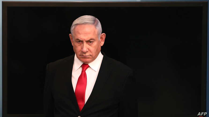 Israeli Prime Minister Benjamin Netanyahu arrives for a speech at his Jerusalem office on March 14, 2020, regarding the new…