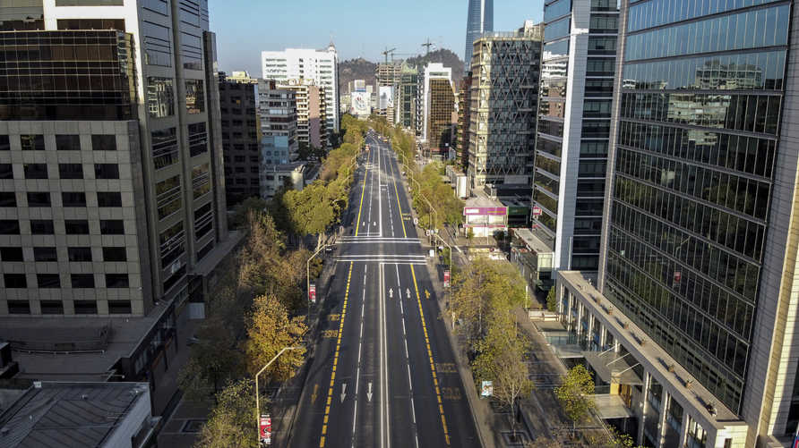 Aerial view of an empty road in Santiago, Chile, on March 22, 2020. - Chile set a night curfew from 22H00 until 05H00 starting…