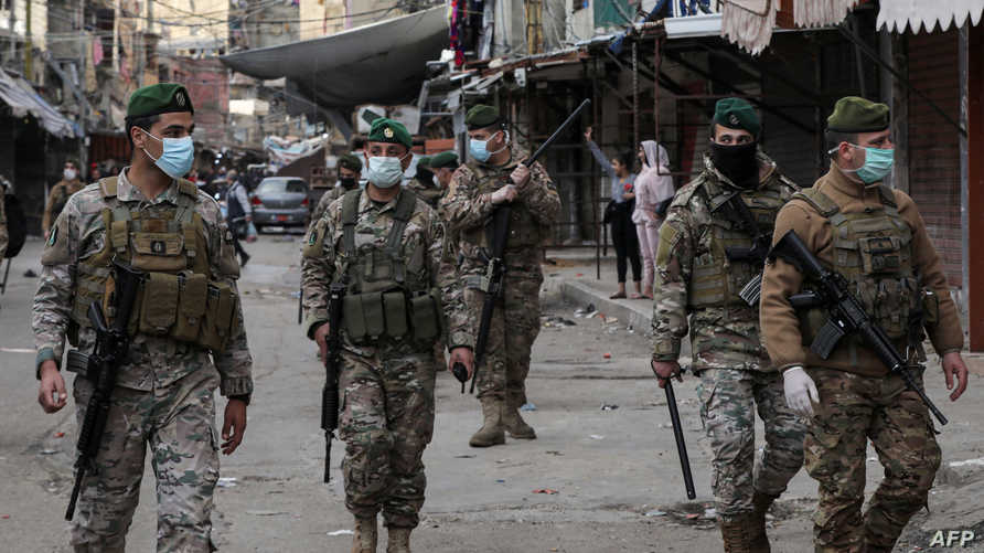 Lebanese army soldiers patrol in the market of the Palestinian refugee camp of Sabra, south of the capital Beirut, as measures…
