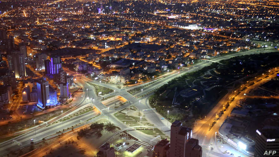A photo taken on March 23, 2020, shows a view of a deserted highway in Kuwait city, a day after authorities declared a…