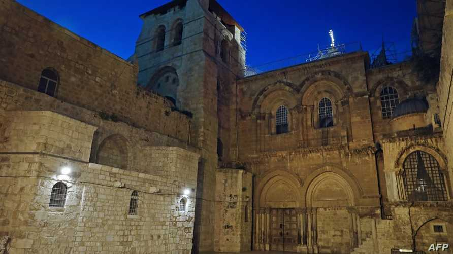 A picture taken on March 25, 2020 shows the Holy Sepulchre Church closed in Jerusalem's Old city due to the coronavirus (COVID…