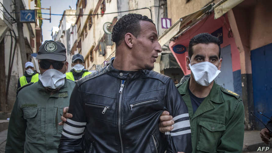 Moroccan authorities arrest a man who refused the confinement as security forces instruct people to return to and remain at…